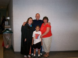 My parents and son with me at graduation.