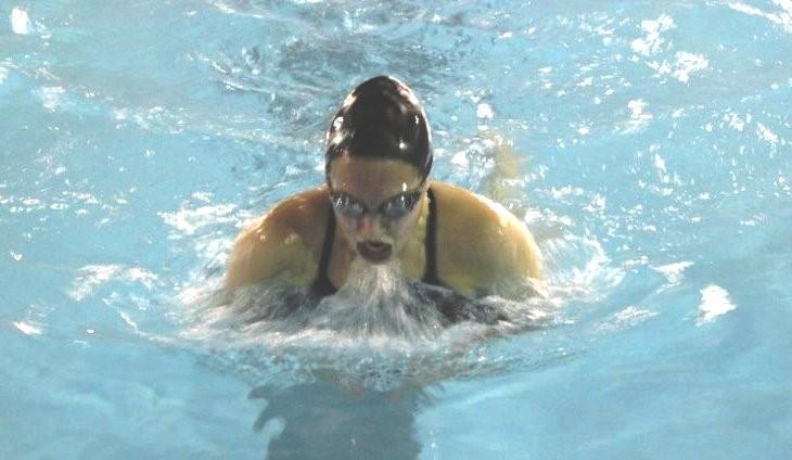 Meg Foster swimming for ACS