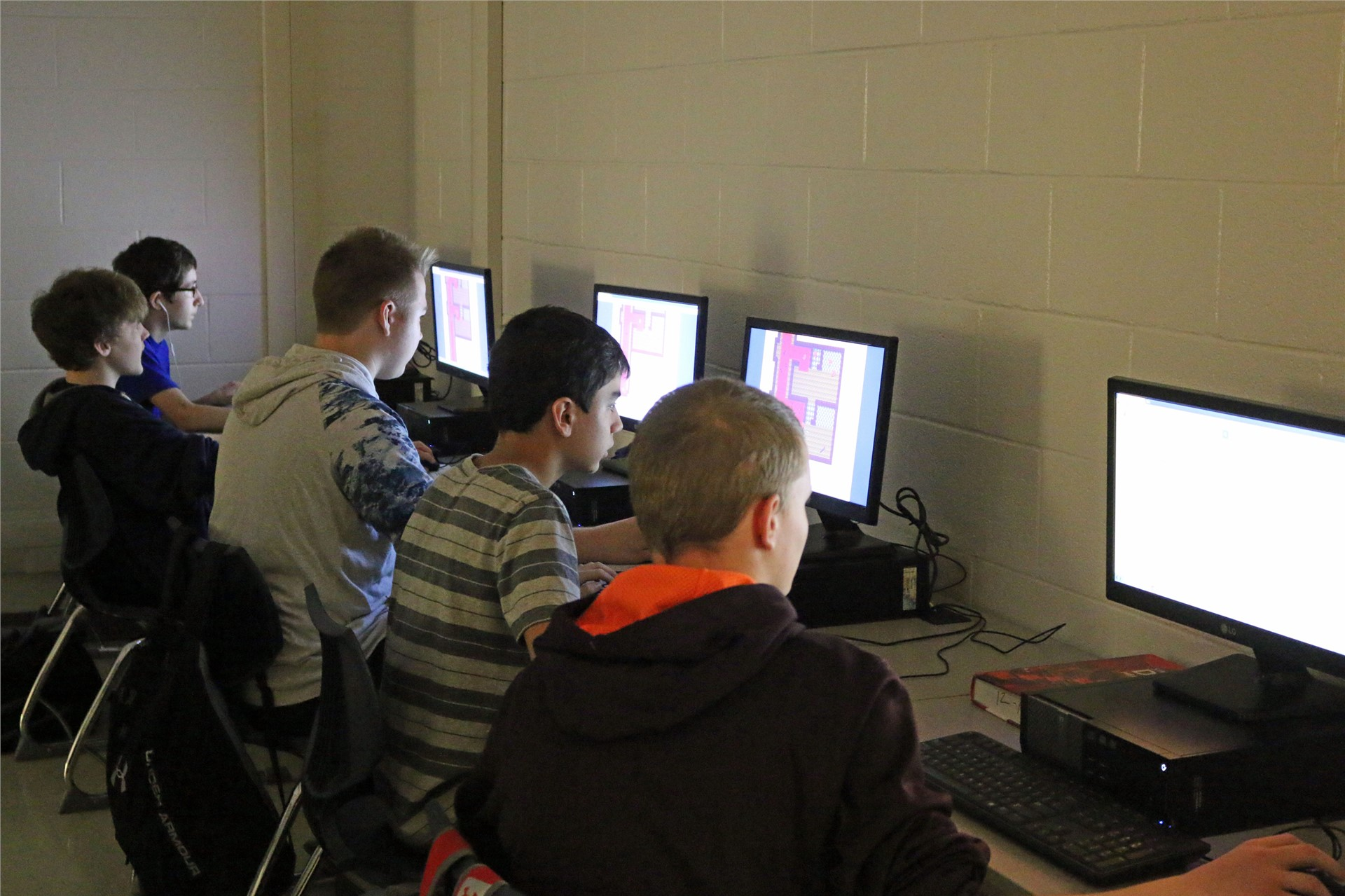 Students engaging in fun activity with computers.