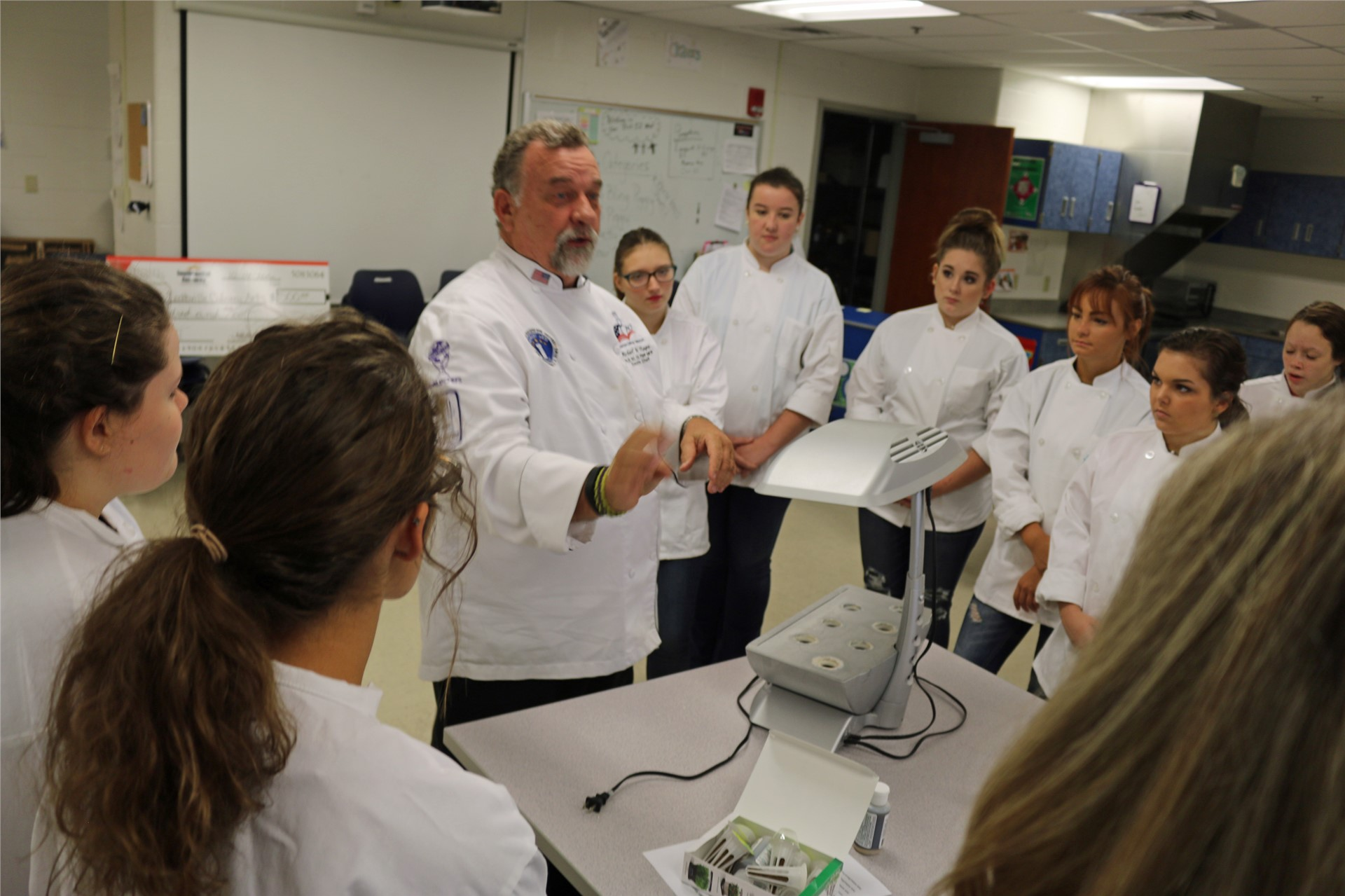 SKYCTC chef teaching students about hydroponic guardening.