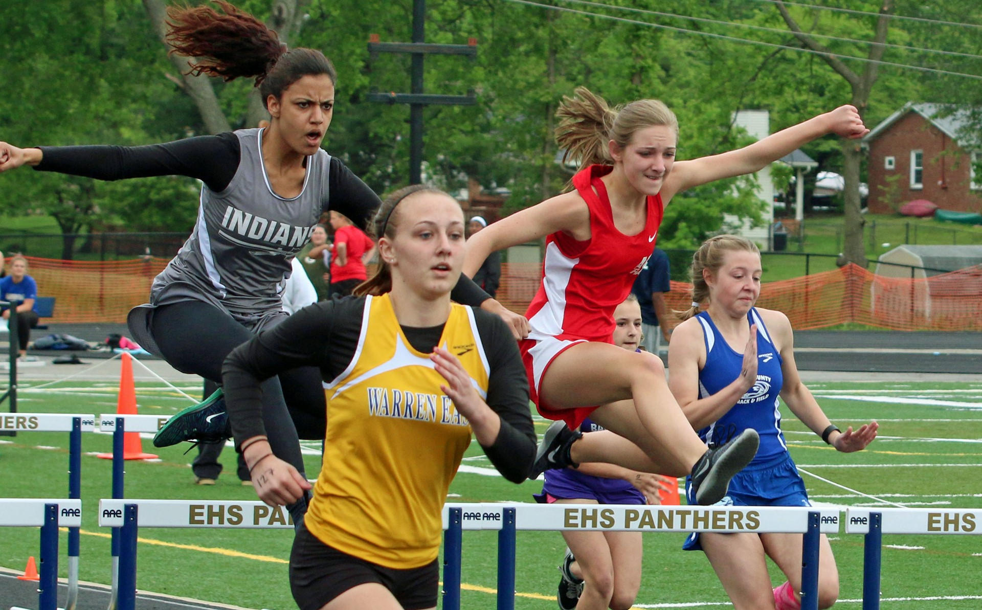 Up and over a hurdle at Region track.