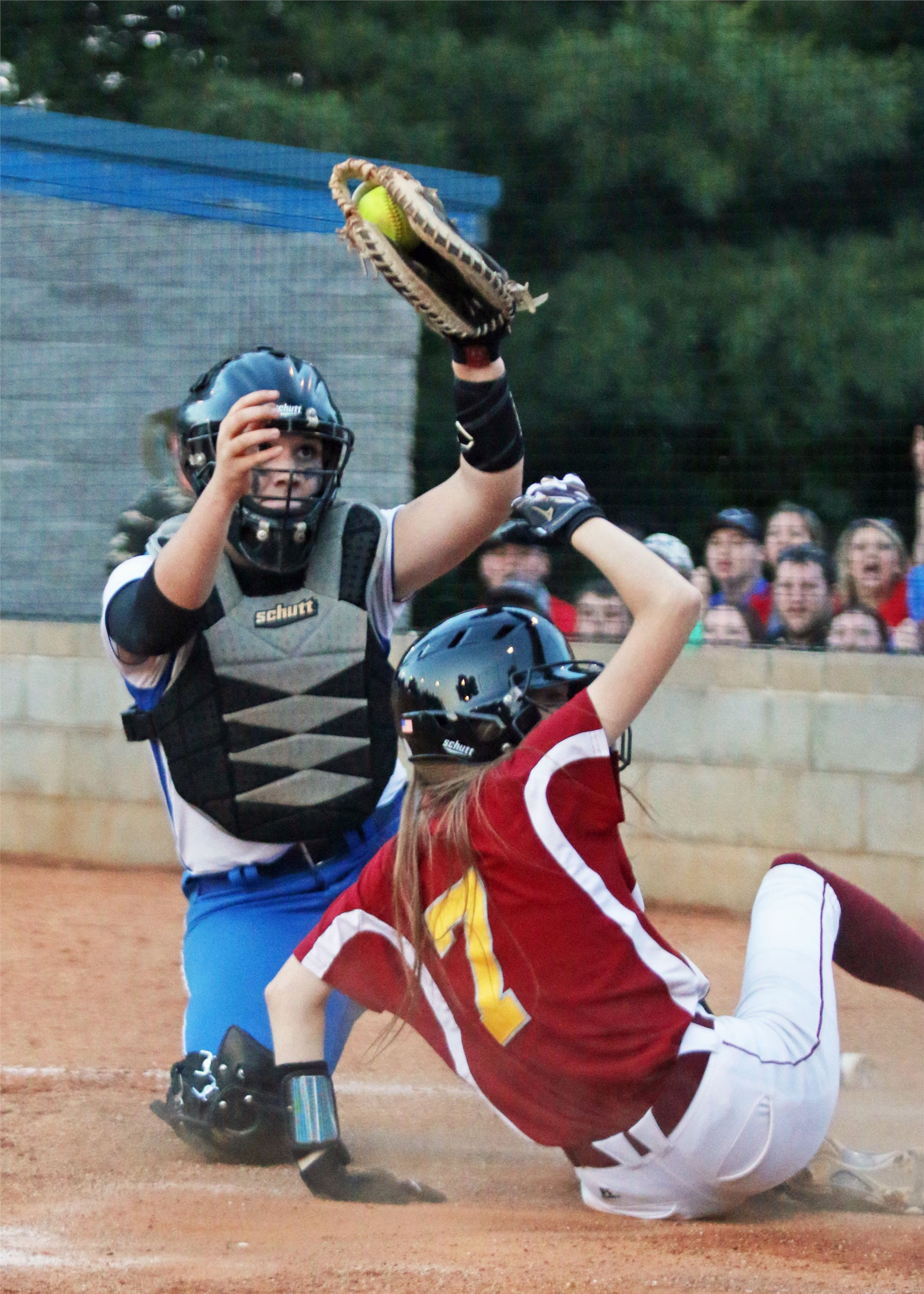 Ryley Whitney with play at the plate.
