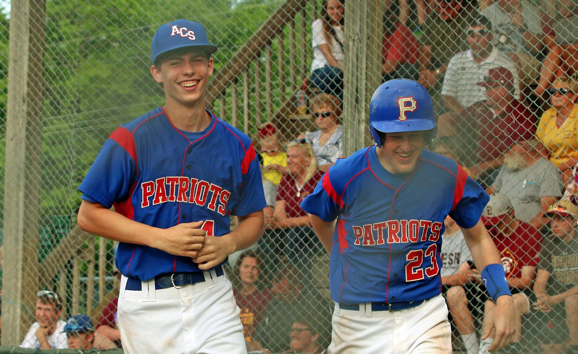 Drew Meador and Marcus Carter all smiles after home run by Carter.