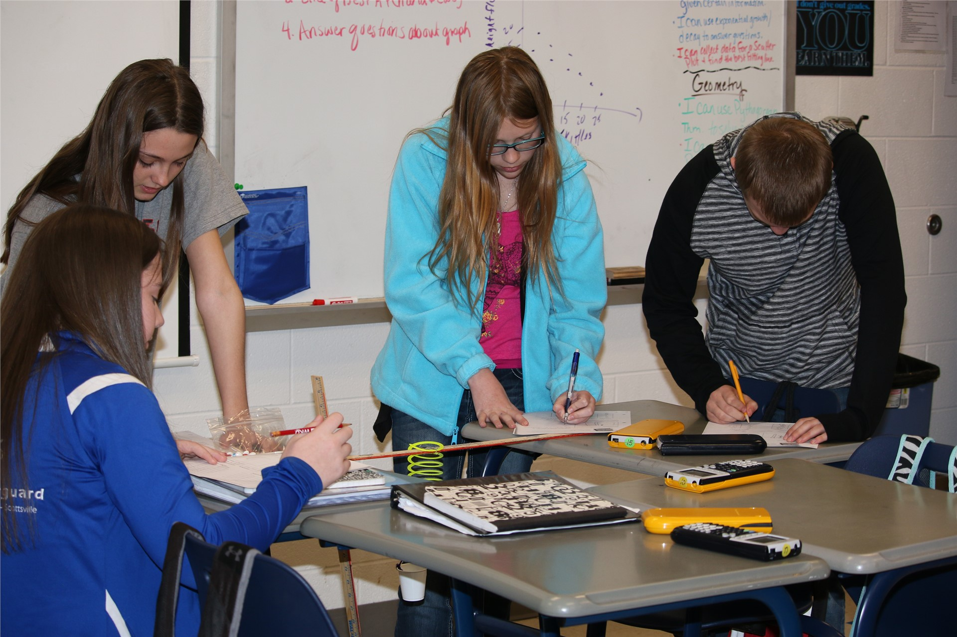 Math students at high school involved during classroom activity.