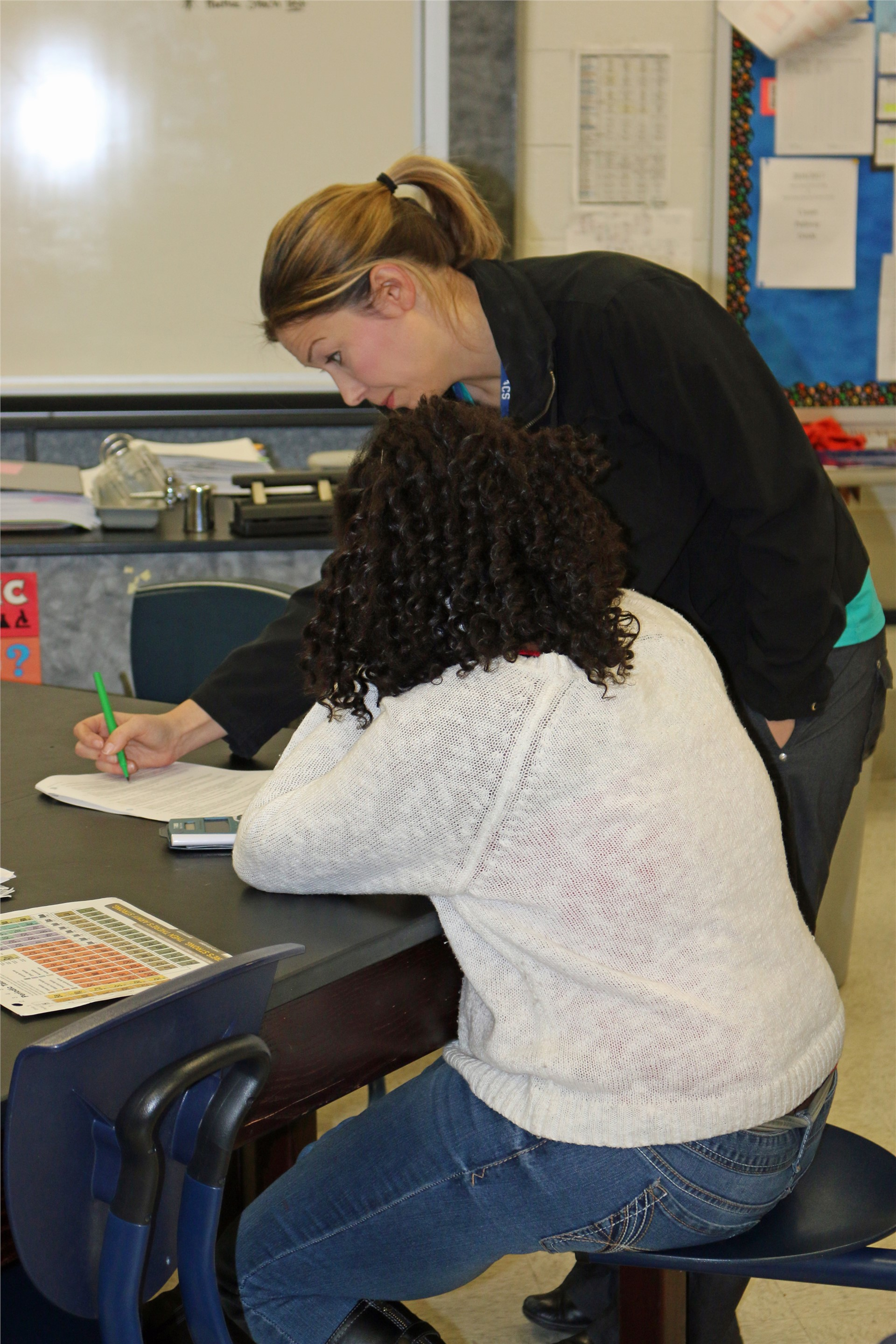ACSH student receives one-on-one instruction from her chemsity teacher.