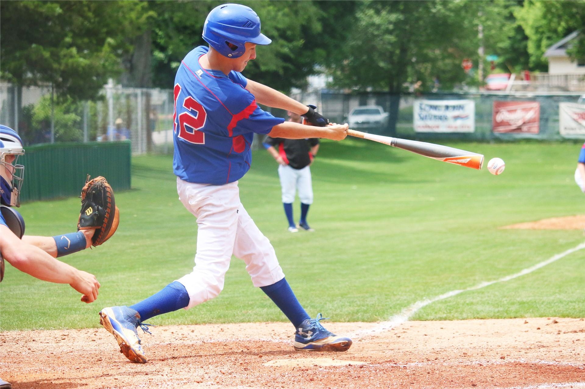Freshman Brett Rippy takes a cut at the ball.