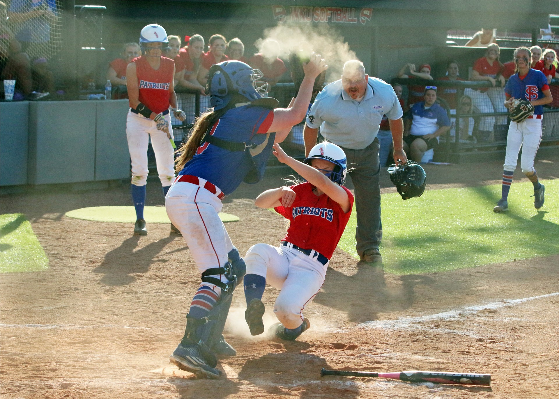 Jaylee Woods slides into the plate.