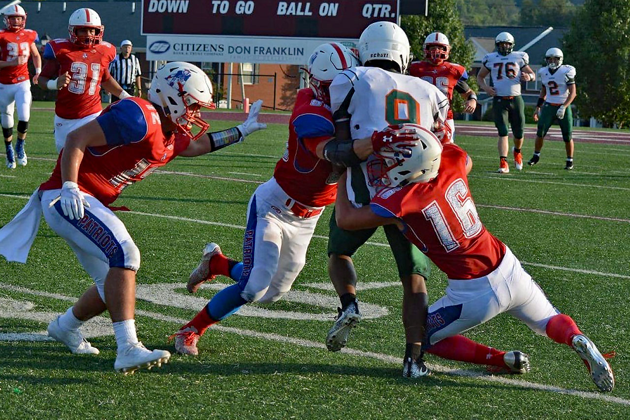 Patriot defenders with a team tackle against Hart County