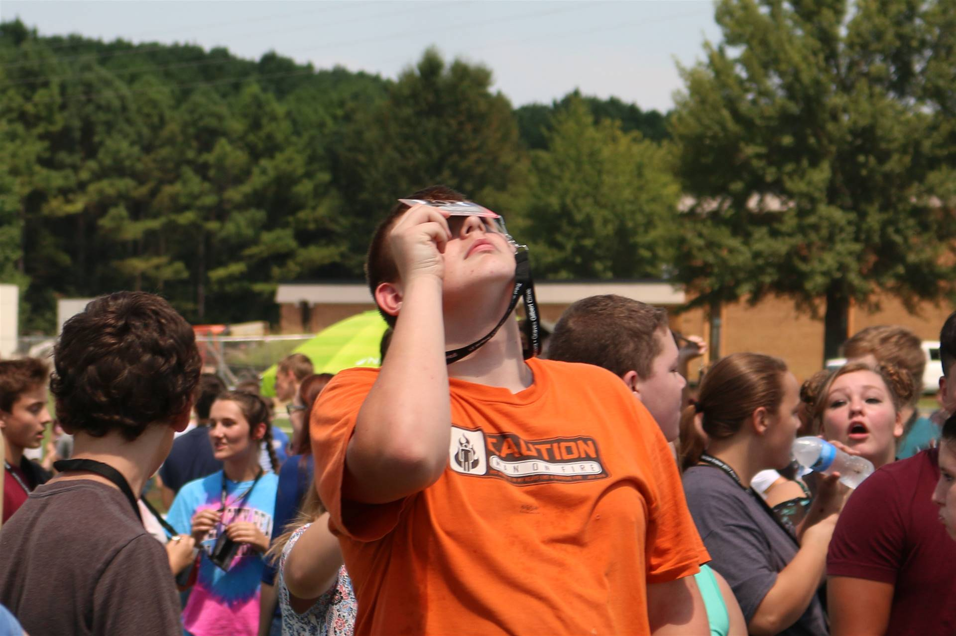 An ACSH student watches the eclispe prior to totality.